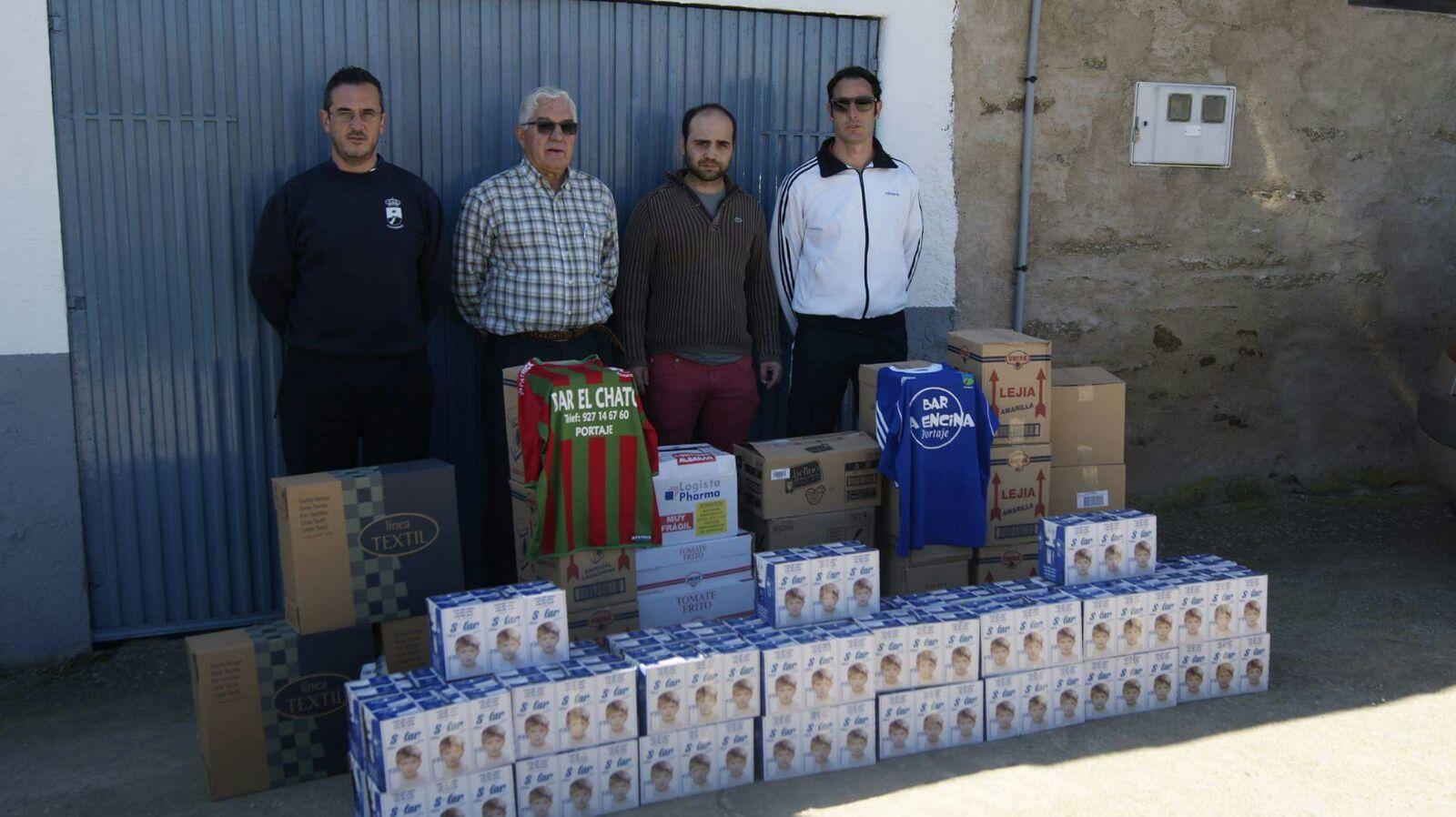 CD Portaje entrega su cesta solidaria a Cáritas